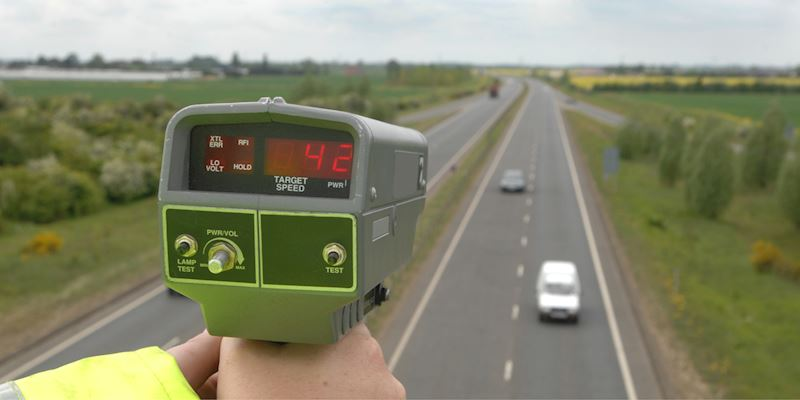 Image shows a mobile speed camera monitoring a dual carriageway in the UK